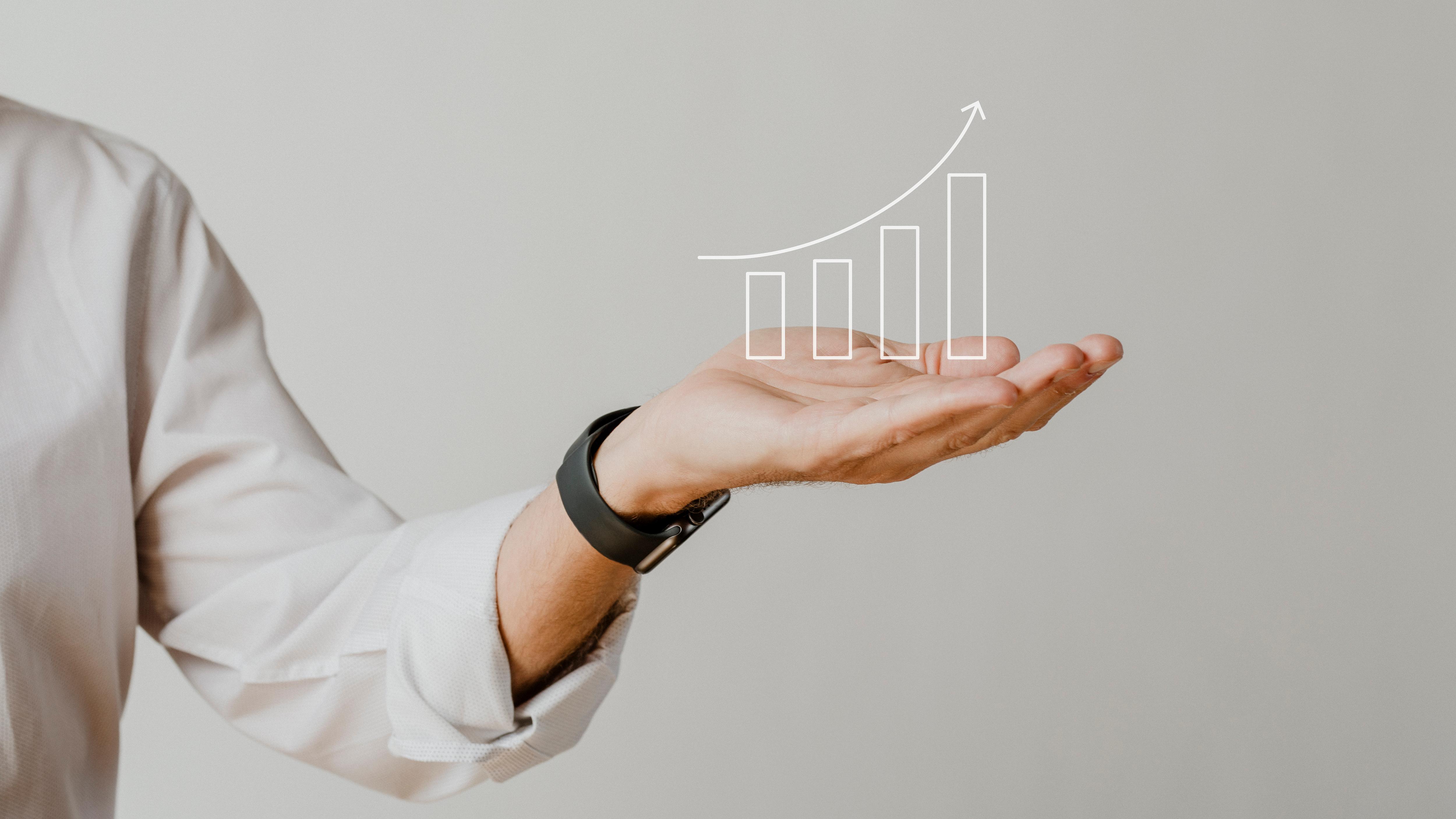 Digital increasing bar graph with businessman hand overlay